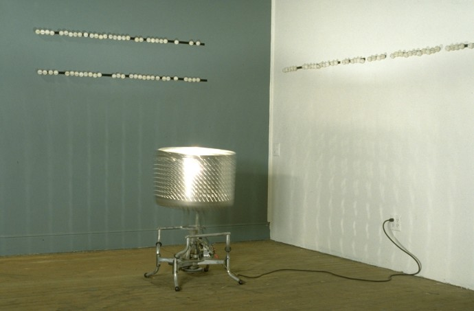 Limited Domain Meaning Machine by Ken Rinaldo and Amy Youngs Premiere at ACME Gallery San Francisco 1995. Washing machine tub, motor, light, electronics, velcro and ping-pong balls with dry transfer lettering.